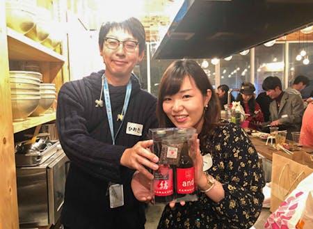ミニゲームで鎌倉ビールを見事獲得した参加者のお二人